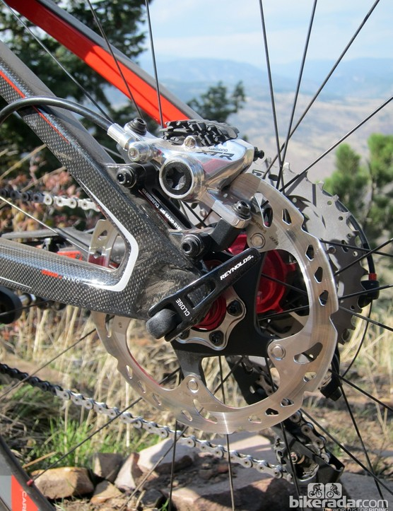 Shimano's superb XTR hydraulic disc brakes mount to IS-style tabs out back