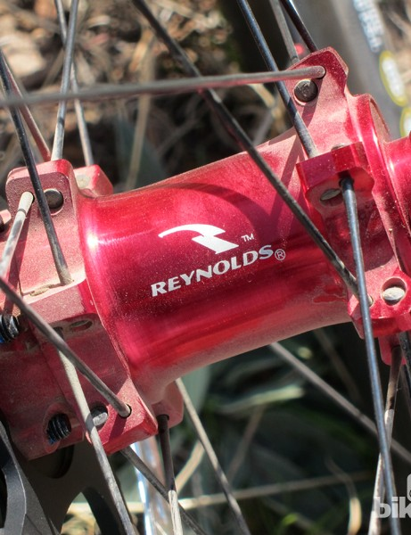 The Reynolds hubs look expensive with their glossy red anodized finish, and they're conveniently convertible to multiple axle fitments but the rear freehub body offers slow engagement speed. In our experience, reliability has also been less than stellar