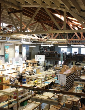 The smell of sardines is gone from this old cannery; 50 employees work to design and build Light & Motion's bike and dive lights