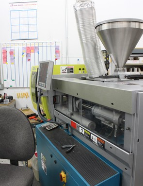 Between 50 and 80 percent of Light & Motion's products are produced in-house. This allows the company to design products in a short time frame. An injection molding machine is shown here