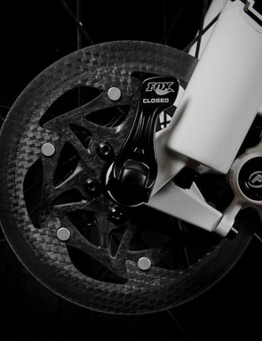 A carbon spider riveted to the braking track adds weight but allows the company to use less of the costly brake track material