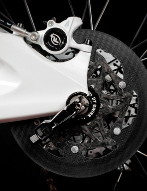Note the lack of milled-out sections from the brake track. On steel rotors these are used to aid in dissapating heat (albeit at the expense of surface area used for braking). The SiCCC rotors ability to withstand higher temperatures and dissapate heat faster than their steel counterparts negates the need for these cutouts
