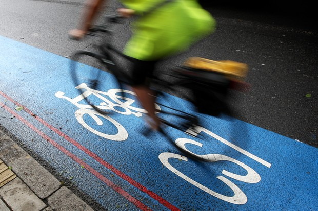 A cyclist uses an existing Cycling Superhighway in London, UK