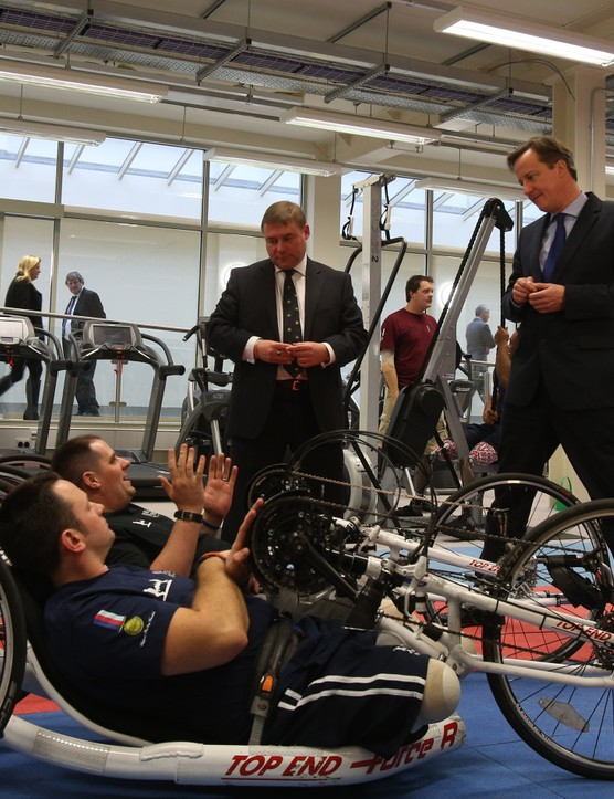 Wounded servicemen Simon Harmer and Steve Arnold with British PM David Cameron