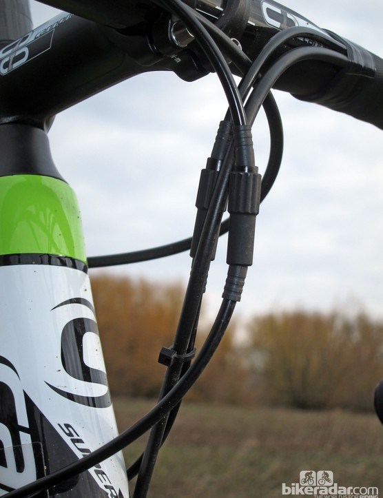 Cannondale conveniently equips the SuperX Hi-Mod Disc with inline barrel adjusters, as there aren't any built into the molded carbon fiber housing stops