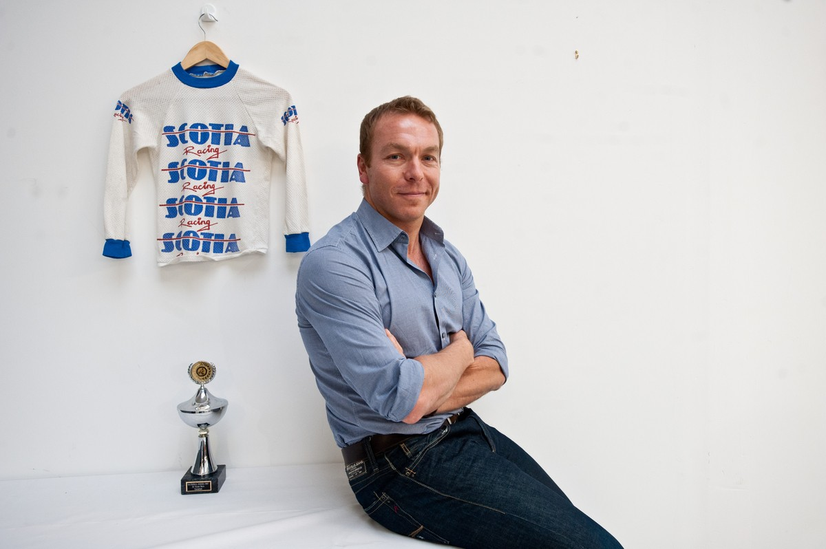 Sir Chris Hoy with his younger self's BMX jersey and trophy