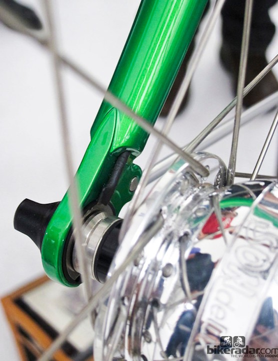 The randonneur frame from Llewellyn Bikes includes integrated racks, dynamos and lights, and was cleanly wired inside the forks