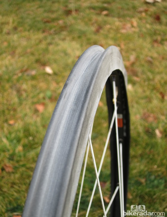 Rims that aren't designated as tubeless can sometimes still be used as such, with a little bit of work. Here, an airtight rim strip has been made out of a 20in inner tube
