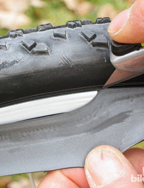 Once your homemade tubeless setup is inflated (and after you've confirmed that it'll sustain a substantial side load without burping), carefully trim the excess material with a razor