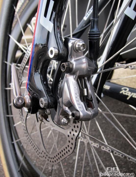 SRAM will build the new Red hydraulic disc brake caliper with two-piece forged aluminum construction. Hardware appears to be titanium throughout