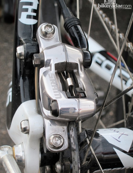 Pads are top-loading and held in place with a threaded pin (note the security clip mounted between the caliper halves, too). The pad doesn't appear to be shared with any other Avid caliper, but the pad spring looks thicker and beefier than on Avid's BB7 mechanical brake