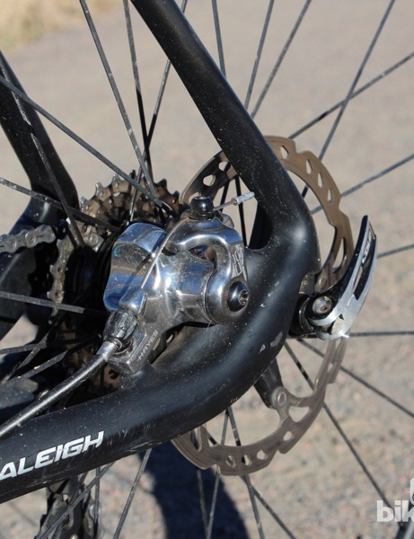 The Raleigh RXC Pro Disc tucks the calipers inside the chain stay, widening the frame at that point