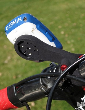 The neat flip-flop design can be clamped on either side of the handlebar depending on your particular cable routing setup