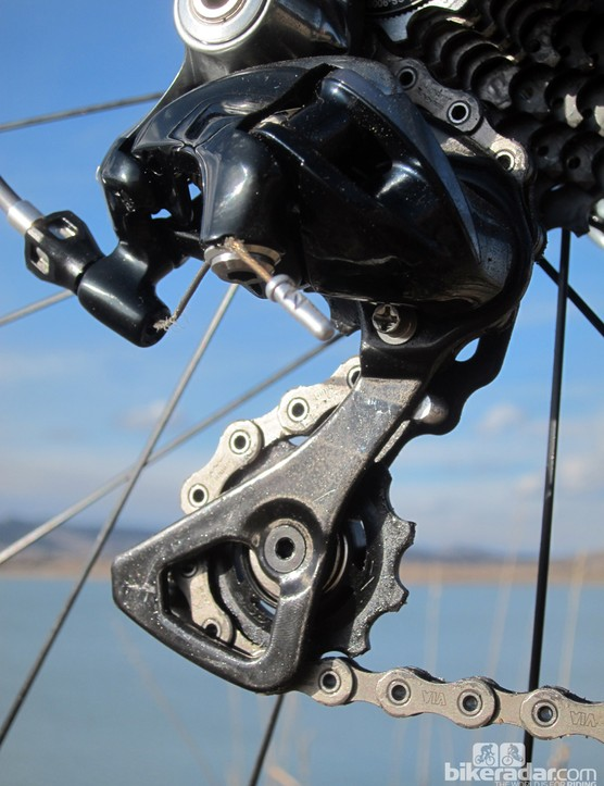 Again, Shimano opts for a carbon fiber pulley cage on its latest Dura-Ace rear derailleur. Note the new low-profile cable anchor bolt, too