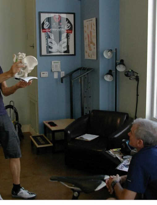 Fitter Kevin Bailey explains to a client how the pelvis interacts with a saddle