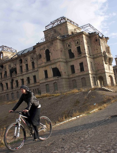 Galpin and her custom Alchemy Agrius 29, pedaling past Darul Aman Palace in Kabul, Afghanistan