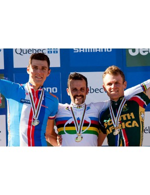 Burry Stander (R) after winning bronze at the 2010 cross country world championships. Jose Antonio Hermida Ramos (C) finished first ahead of Jaroslav Kulhavy (L)