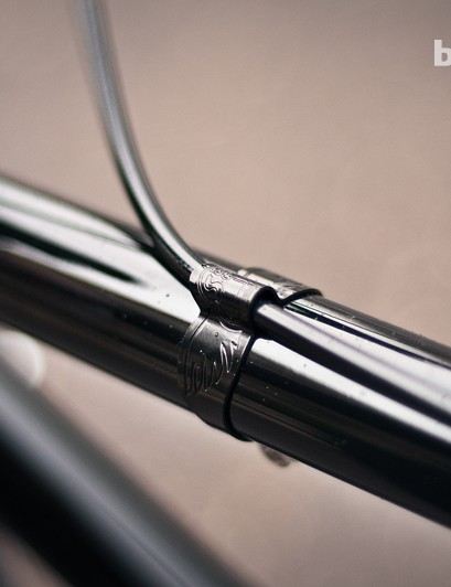It's only a bent bit of metal but the monogrammed cable clips are a nice touch on a bike that's desperately short of them