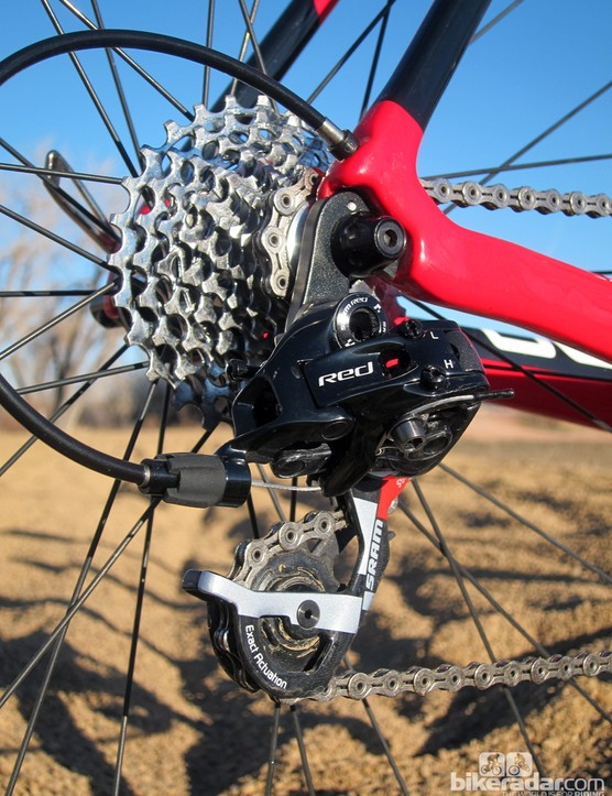 The internally routed rear derailleur cable pops out back at the rear dropout. The SRAM Red shifters and rear derailleur are matched to a SRAM PG-1070 cassette