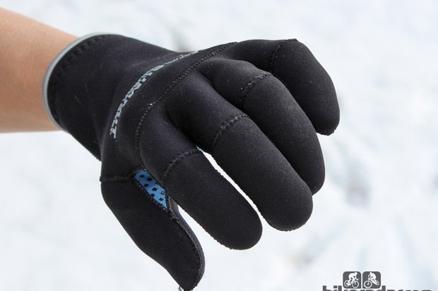 The fingers are constructed with multiple, smaller pieces of neoprene to produce that natural curve