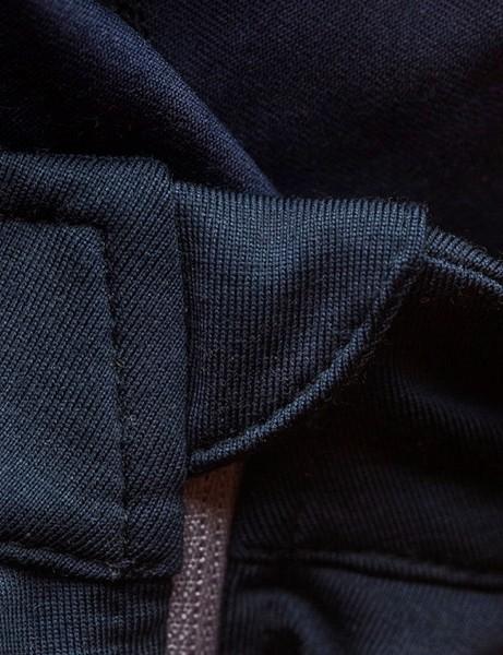 A zipper garage keeps the neckline smooth