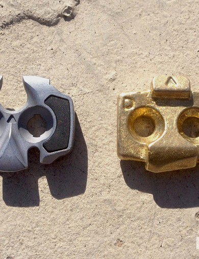 While the two-bar design of these pedals appears similar, the cleats show considerable differences: steel LOOK cleat on the left and the brass Time cleat at right