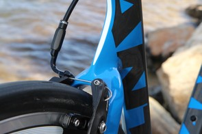 Both brakes use a cable noodle that can simply be removed to open the arms up for wheel removal - just like an old mountain bike V-brake. A barrel adjuster is integrated into the end for fast on-the-fly adjustments