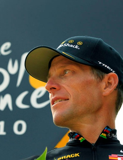 Lance Armstrong looks back on the podium after the 20th and last stage of the Tour de France cycling race in Paris