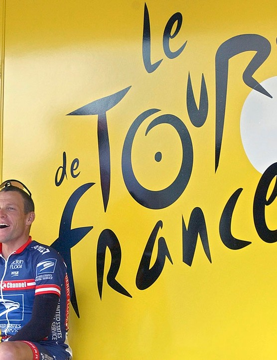 US Postal Service team leader Lance Armstrong sits by the registration bus before the second stage of the 91st Tour de France