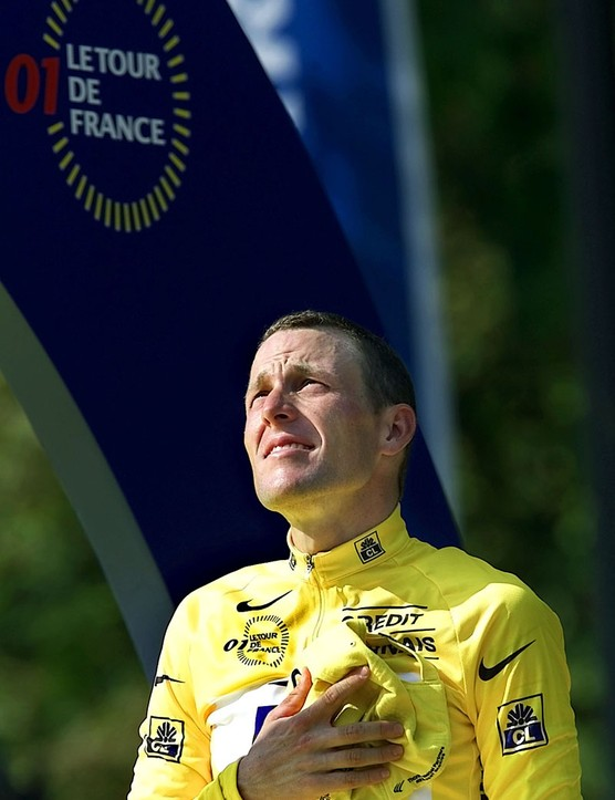 Lance Armstrong stands during ceremonies after winning the Tour de France cycling race following the 20th and final stage in Paris