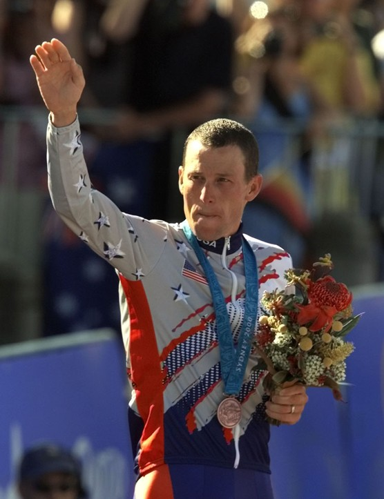 U.S. cyclist Lance Armstrong waves after receiving the bronze medal in the men's individual time trials at the 2000 Summer Olympics cycling road course in Sydney, Australia. Officials familiar with the decision tell The Associated Press the IOC has stripped Armstrong of his bronze medal from the 2000 Sydney Olympics because of his involvement in doping.