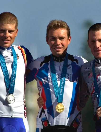 Russia's Viacheslav Ekimov, center, winner of the gold medal in the men's individual time trials, celebrates with Germany's silver medal winner Jan Ullrich, left, and U.S bronze medal winner Lance Armstrong at the cycling road course in Sydney, for the Summer Olympic Games. Officials familiar with the decision tell The Associated Press the IOC has stripped Lance Armstrong of his bronze medal from the 2000 Sydney Olympics because of his involvement in doping.