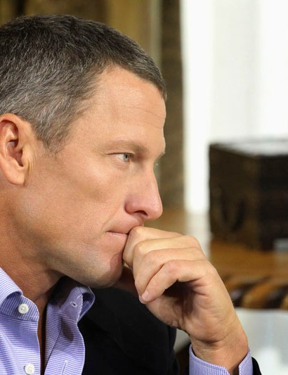 Lance Armstrong listens during an interview with US talkmaster Oprah Winfrey at his home in Austin, Texas