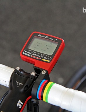 A red SRM PowerControl 7 computer head is affixed to an aluminum mount on Philippe Gilbert's (BMC) BMC TeamMachine SLR01