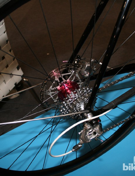 Disc brakes and a SRAM drivetrain - it's more about the purple anodising though