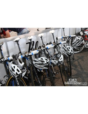 Helmets are washed after training rides and race stages, then hung back on a rider's bike before the next day's outing