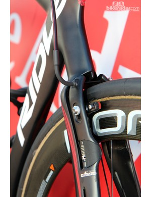 Lotto-Belisol's Ridley Noah FAST linear-pull brakes have a blended shape that is molded directly with the frame itself. The stainless steel cable noodle is dressed up with a bit of heat-shrink tubing to match the rest of the bike