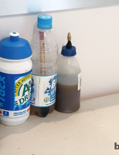 The bottle in the middle contains solvent, to keep glue brushes from hardening between tire installations