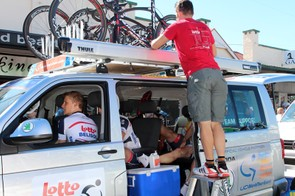 Rented minivans and roof racks meant using stepladders to retrieve bikes before the start of the stage