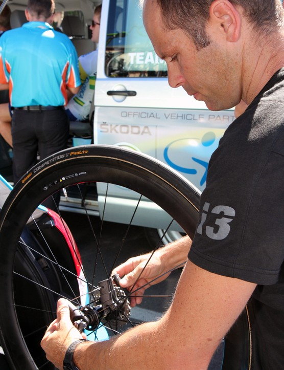 Orica-GreenEdge mechanic Craig Geater preadjusts quick-release skewers on spare wheels to help ensure a fast change