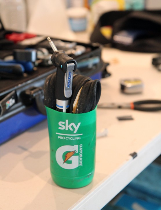 Like many teams, Sky supplies its riders with a spare tubular and pump stuffed into a cut-off water bottle for training rides