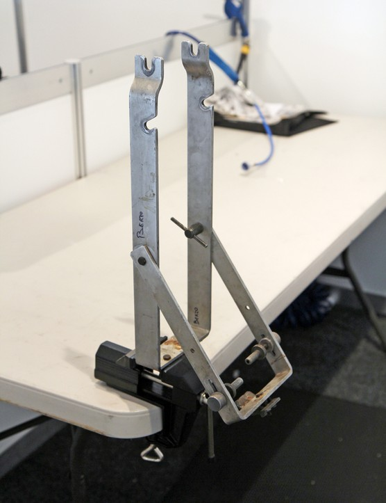 This truing stand doesn't look like much but it can be securely clamped to tables and works well for road wheels