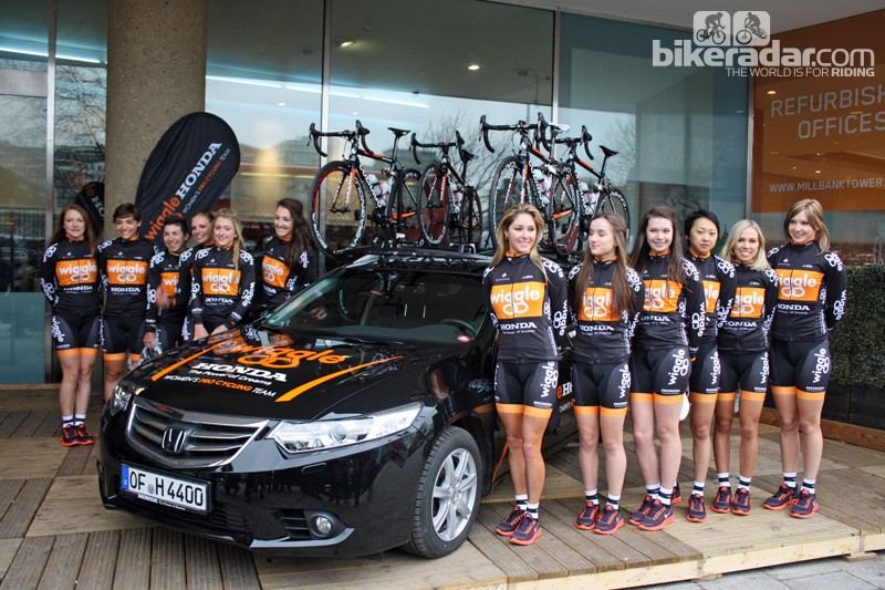179e6fe6ec2 The Wiggle Honda Women's Pro Cycling team stand alongside their Honda team  car