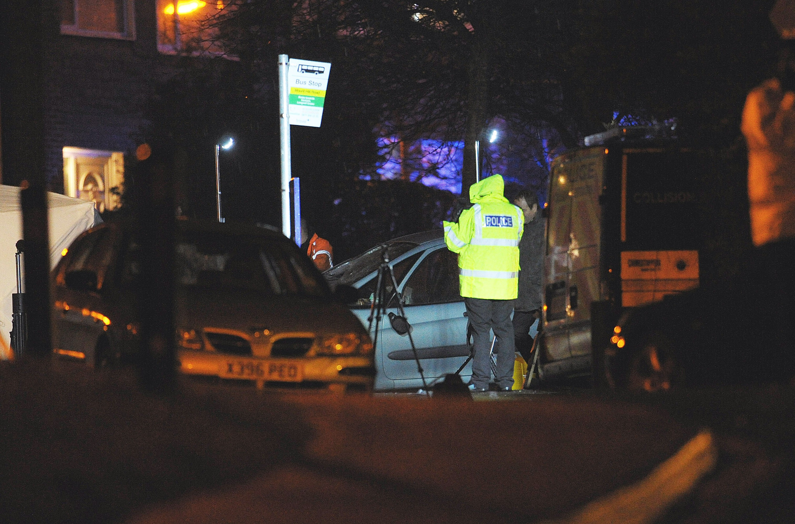 The Citroen Picasso surrounded by police investigators on Lower Hanham Road, Bristol