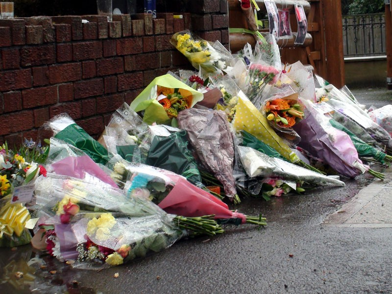 Tributes left to husband and wife Ross and Clare Simons on Lower Hanham Road, Hanham, near Bristol