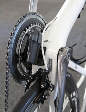 The bottom bracket is a busy area on Jens Voigt's (RadioShack Leopard) Trek Madone 7 Series. Bearings are pressed directly into the 90mm-wide shell, the Shimano Dura-Ace Di2 battery is mounted beneath, and right behind is a special Shimano Dura-Ace brake caliper