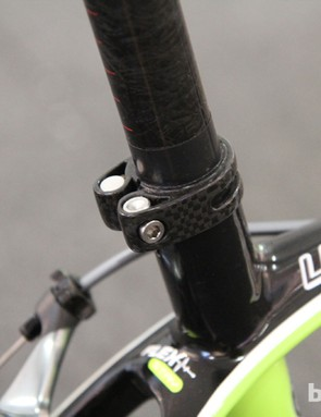 The seatpost is clamped with a carbon fiber collar