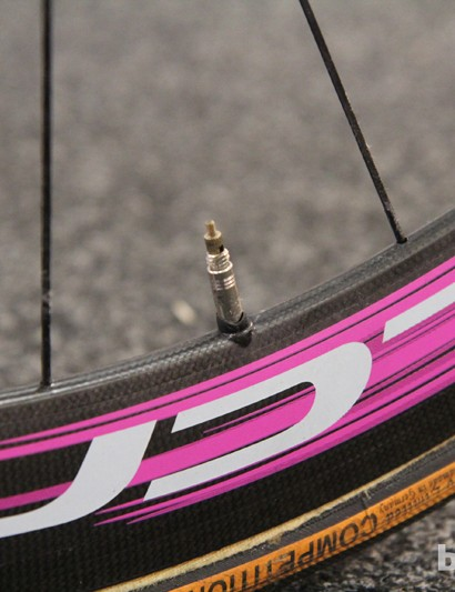 Plastic sleeves keep the valve stems from rattling inside the deep-section carbon fiber rims