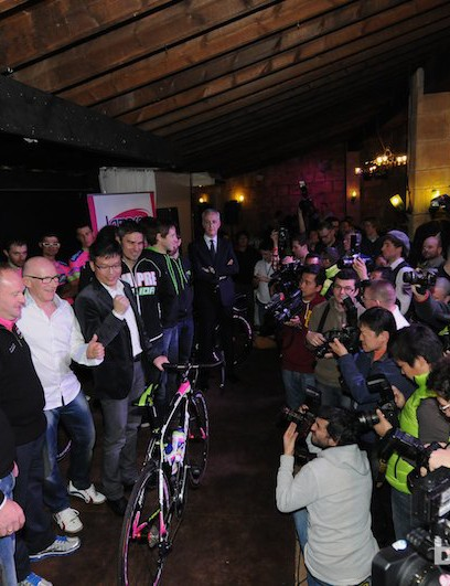 The media scrum for photographs of the team and management
