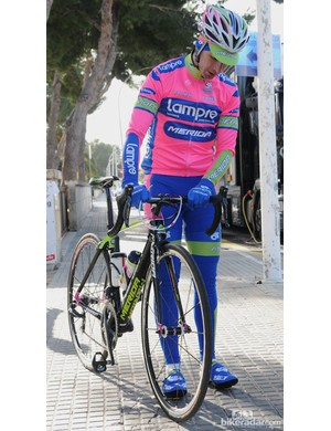 Making final checks before heading out for a training ride in the cool Mallorcan sun